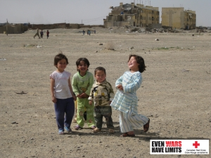 These bashful Afghan children offer a stark juxtaposition to their surrounding environment. Residential buildings (shown in the background) are dilapidated due to ongoing conflict and extreme    poverty. According to the translator who was assigned to me that day, most people in this community have lost at least one family member due to war in the past three decades.